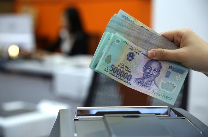 """Ngành tài chính ngân hàng cẩn trọng với """"gia vị"""" nợ xấu"""